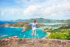 Little adorable kid with beautiful famous view. View of English Harbor from Shirley Heights, Antigua, paradise bay at. View of English Harbor from Shirley Royalty Free Stock Images