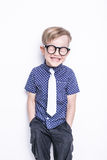 Little adorable kid in tie and glasses. School. Preschool. Fashion. Studio portrait isolated over white background Royalty Free Stock Photography