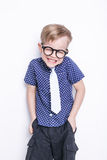 Little adorable kid in tie and glasses. School. Preschool. Fashion. Studio portrait isolated over white background Stock Images