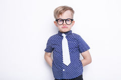 Little adorable kid in tie and glasses. School. Preschool. Fashion. Studio portrait isolated over white background Stock Image
