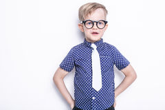 Little adorable kid in tie and glasses. School. Preschool. Fashion. Studio portrait isolated over white background Stock Photos