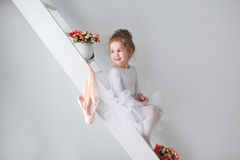 Little adorable young ballerina in a playful mood. Stock Photos