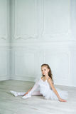 A little adorable young ballerina in a playful mood in the inter Stock Images