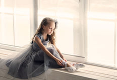 A little adorable young ballerina in a playful mood in the inter royalty free stock photos