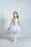 A little adorable young ballerina in a playful mood in the inter Royalty Free Stock Photo