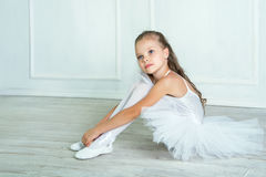 A little adorable young ballerina in a playful mood in the inter Stock Photo