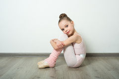 A little adorable young ballerina poses Royalty Free Stock Image