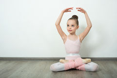 A little adorable young ballerina poses Stock Images