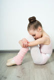 A little adorable young ballerina poses Royalty Free Stock Images