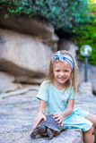 Little adorble happy girl with small turtle Royalty Free Stock Photography