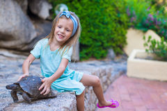 Little adorble happy girl with small turtle Stock Photography