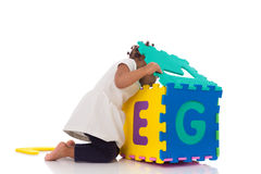 Little African American baby girl playing with construction game Stock Photography