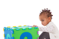 Little African American baby girl playing with construction game Royalty Free Stock Photo