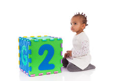 Little African American baby girl playing with construction game Royalty Free Stock Photography