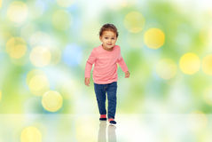 Little african american baby girl walking Stock Images
