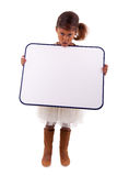 Little african american girl holding a whiteboard Royalty Free Stock Photography