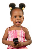 Little african american girl with cell phone. Little African American girl with mobile phone smiling and looking at the camera stock image