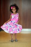 Little african-american girl modeling on runway. Beautiful little african-american girl modeling a floral dress Royalty Free Stock Image
