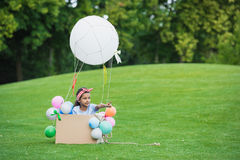Little african american girl playing with diy hot air balloon in park Royalty Free Stock Photo