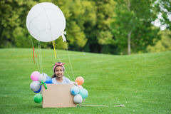 Little african american girl playing with diy hot air balloon in park Stock Image