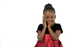 Little african american girl talking to the phone. On white background stock images