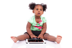 Little african american girl using a tablet pc Royalty Free Stock Photography