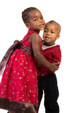 Little African American Sister and Bother Hug Stock Photos