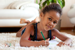 Little African Asian girl  drawing Stock Photo