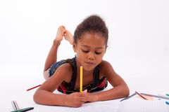Little African Asian girl  drawing Royalty Free Stock Photos