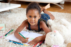 Little African Asian girl  drawing Royalty Free Stock Photo
