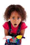 Little African Asian girl with painted hands. In colorful paints royalty free stock photos