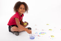 Little African Asian girl painting on the floor Royalty Free Stock Photos