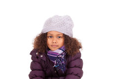 Little african asian girl wearing winter clothes Stock Photos