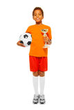 Little African boy holding soccer ball and prize Royalty Free Stock Photo