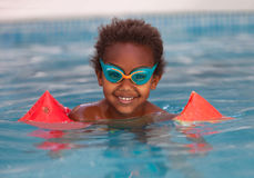 Little african child with orange sleeve float royalty free stock photography
