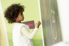 Little african girl drawing on the board Royalty Free Stock Photography
