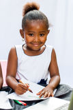 Little African girl drawing with crayons. Stock Photography