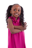 Little african girl with folded arms Stock Images