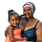 Little african girl on mothers lap. Stock Image