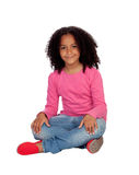 Little african girl sitting on the floor Stock Images