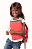 Little african school girl. Cute African American school  girl with books and backpack over white background Stock Photography