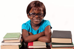 Little african school girl smiling with arms fold Stock Image