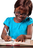 Little African American school girl wearing reading glasses Royalty Free Stock Images