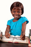 African american school girl. Cute and smiling african american  school  girl studying over white background Stock Photo