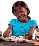 Smiling schoolgirl studying Stock Image