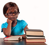 Little African school girl looking bored. African school girl wearing glasses looking bored  over white background Stock Images