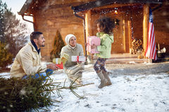 Little afro girl receiving Christmas presents from parent Stock Photography