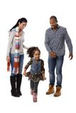 Little afro girl running parents watching Stock Photos