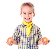 Little agriculturist holding onions Stock Images