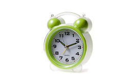 Little alarm clock and gift on background Stock Photos